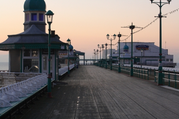 the pier looks eirily quiet after sunset