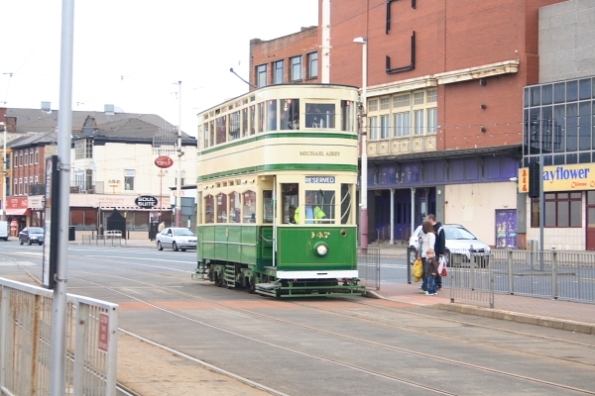 Another historic Blackpool tram passing by.